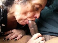 Amateur granny sucking on a black shaft