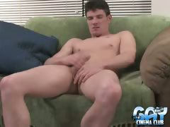 Hefty brunette gay wanking his immense schlong on the couch