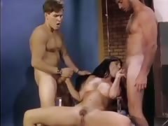 Nasty slut works on two big cocks in 1970s porn
