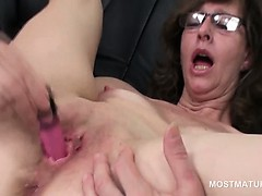 Turned on mature lady masturbating with panties and toys